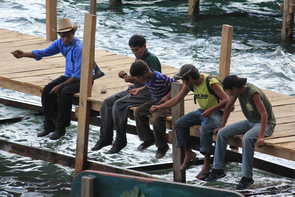 Boys fish of the dock in Santa Cruz de Atitlan