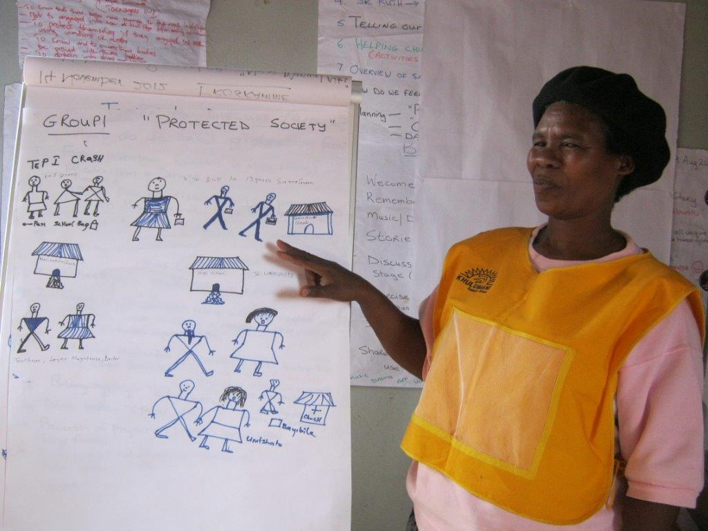 A Gogo presents her Group's discussion findings at the final workshop