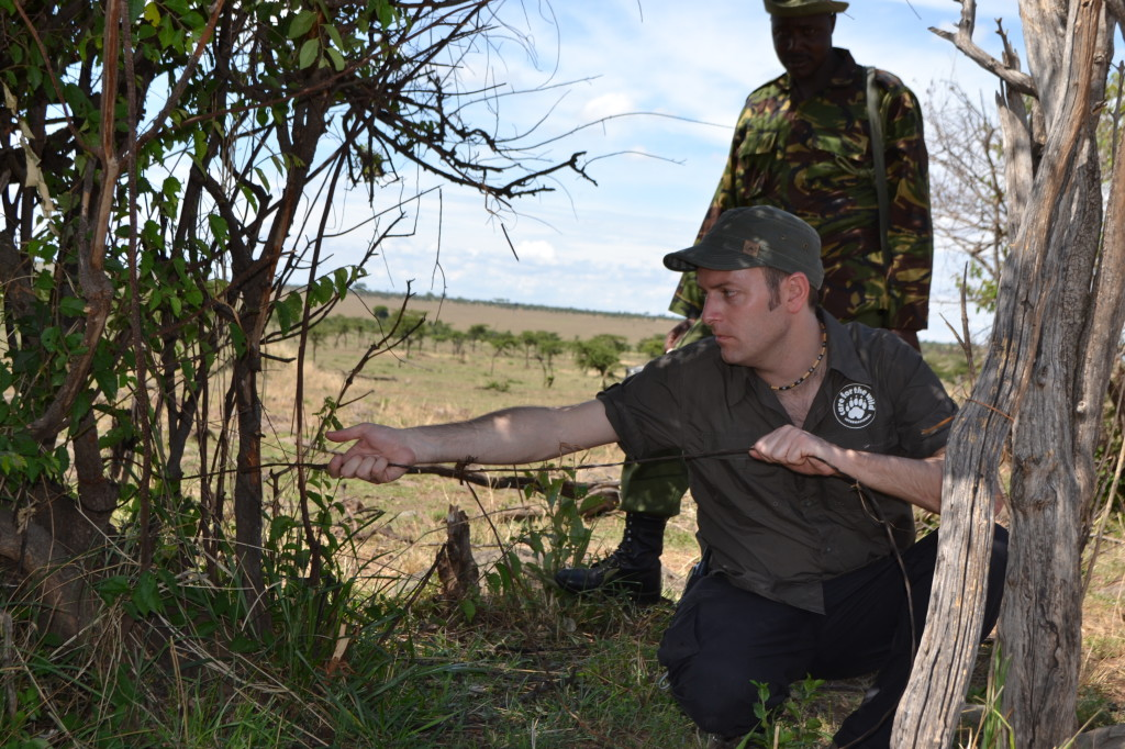 Philip removing a snare on patrol with our Kenyan team
