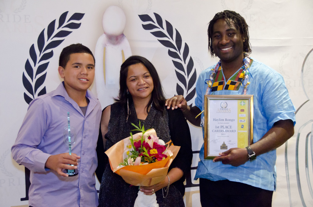 Moses Ariama presenting a Pride Award for community service
