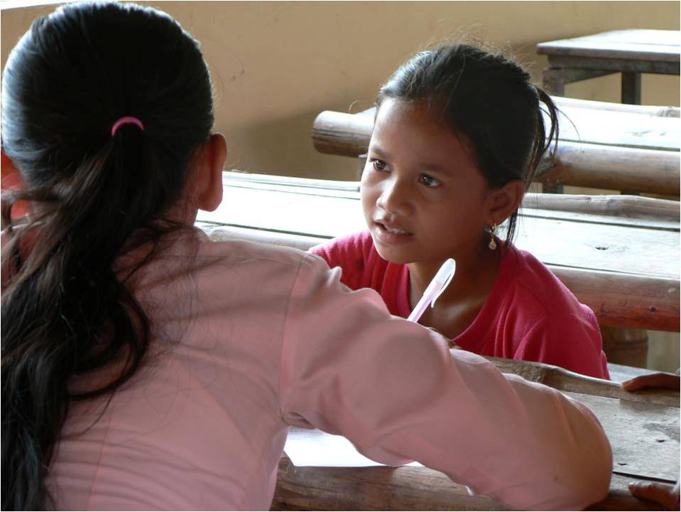 One of the girls at an after-school class, learning English
