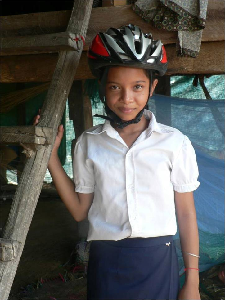 She is so proud of going to school, and she ran to get her bike helmet to show us.