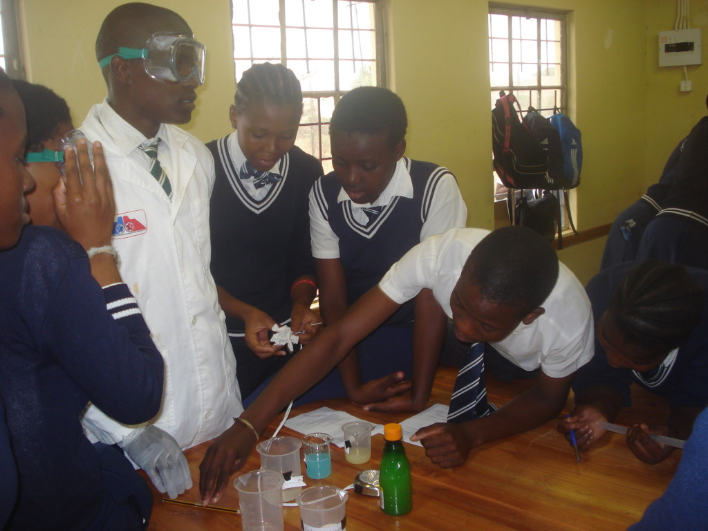 Khethelo conducting science experiments with students