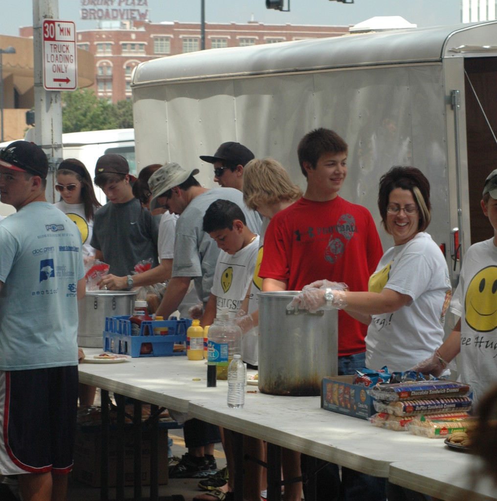 A group of young Spark Givers feeding the homeless.