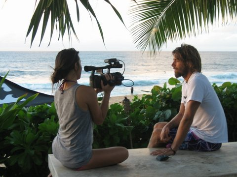 Angela interviewing pro surfer Dave Rastovich for Plastic Paradise