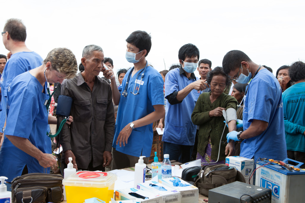 International medical staff working alongside local doctors in mobile rural clinic. photo credit: Paul Pichugin Photography.
