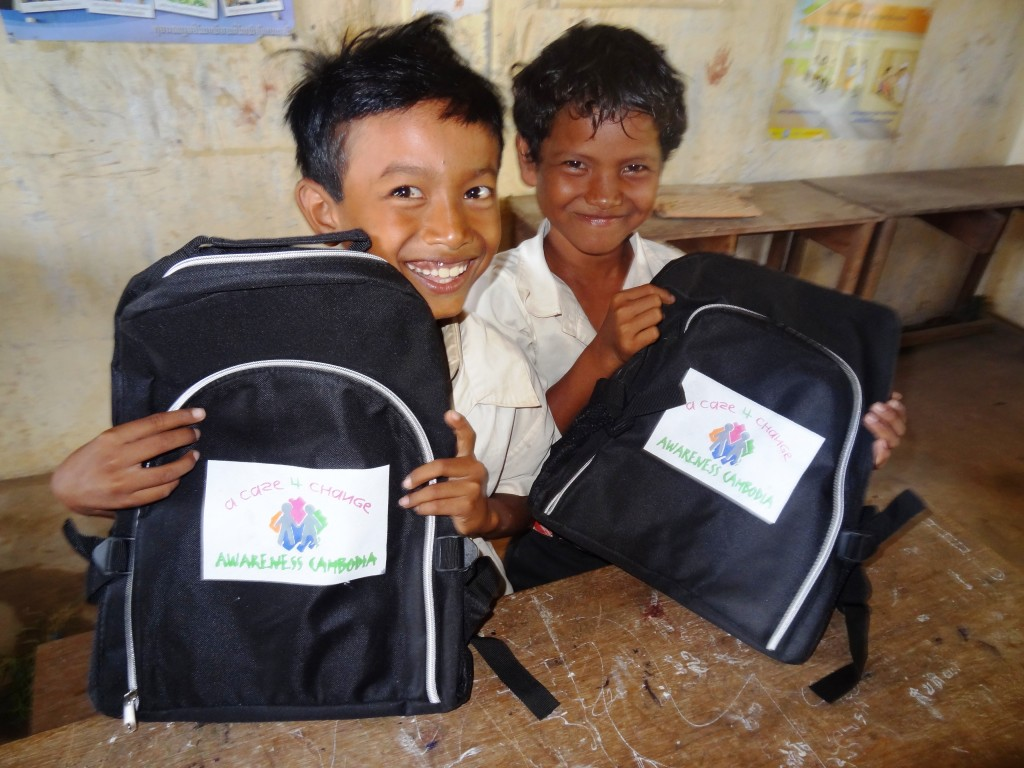 Local primary school students receiving school supplies, through the Case for Change program. Photo credit: Awareness Cambodia.