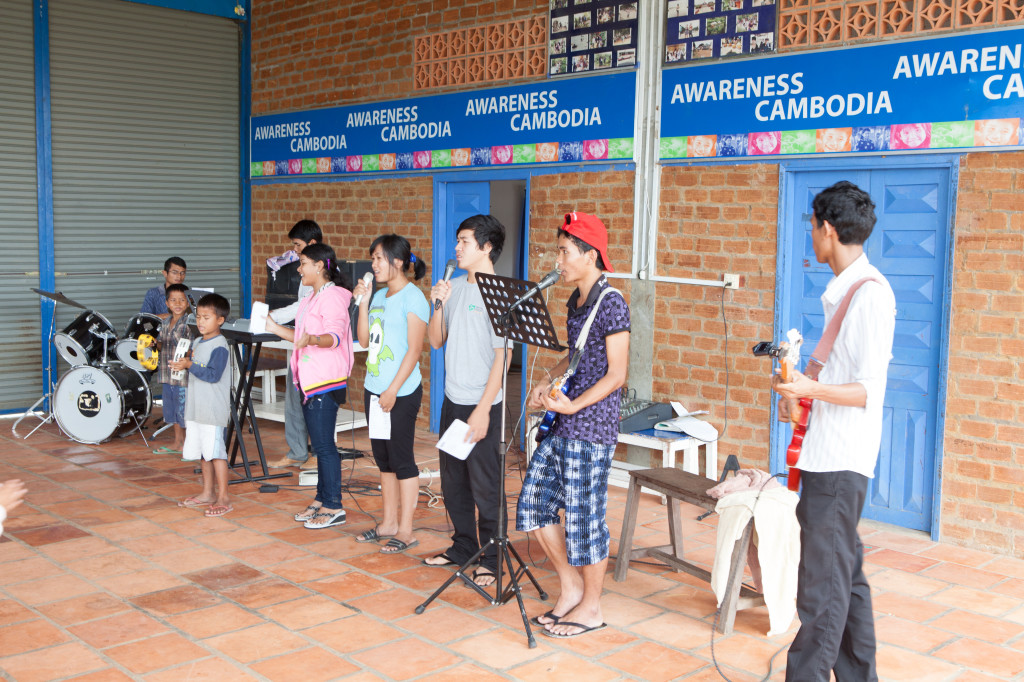 Sunshine House children putting on a concert for the community. Photo credit: Paul Pichugin Photography.