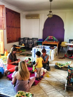 Inside the orphanage volunteers play with the children
