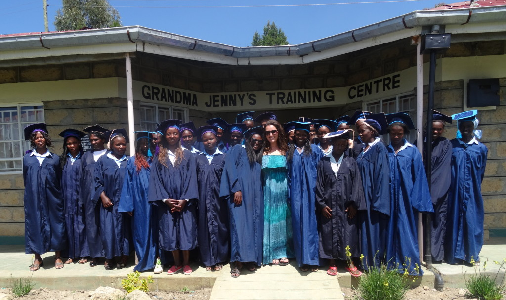 Genna standing proudly with the first graduates of Grandma Jenny's Training Centre, in 2013.