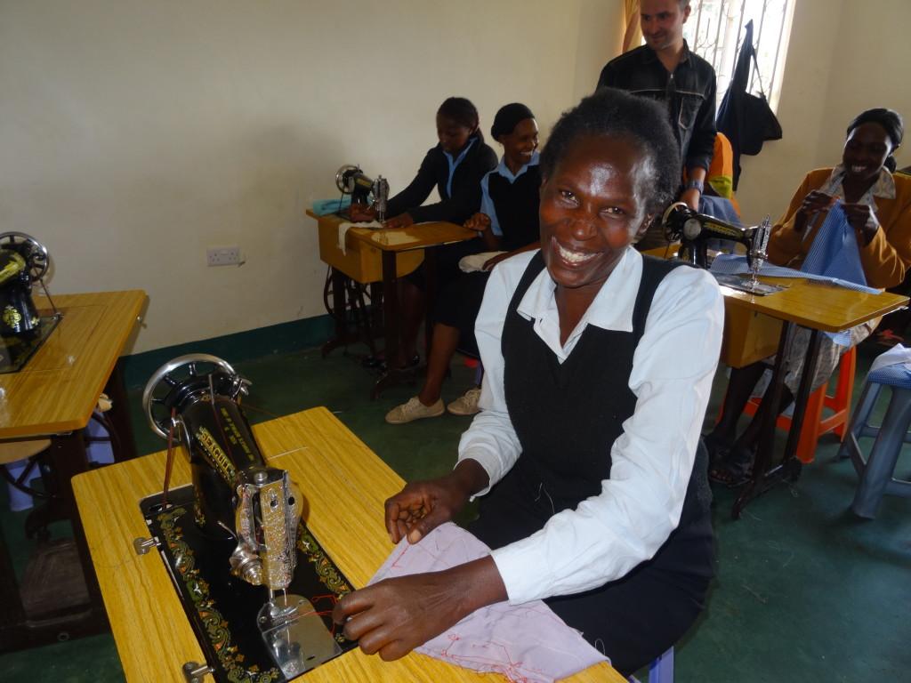 A Grandma Jenny's Training Centre graduate, making school uniforms.