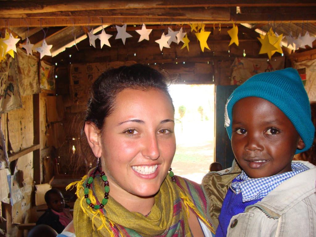 Genna at the original kindergarten, with one of the students.