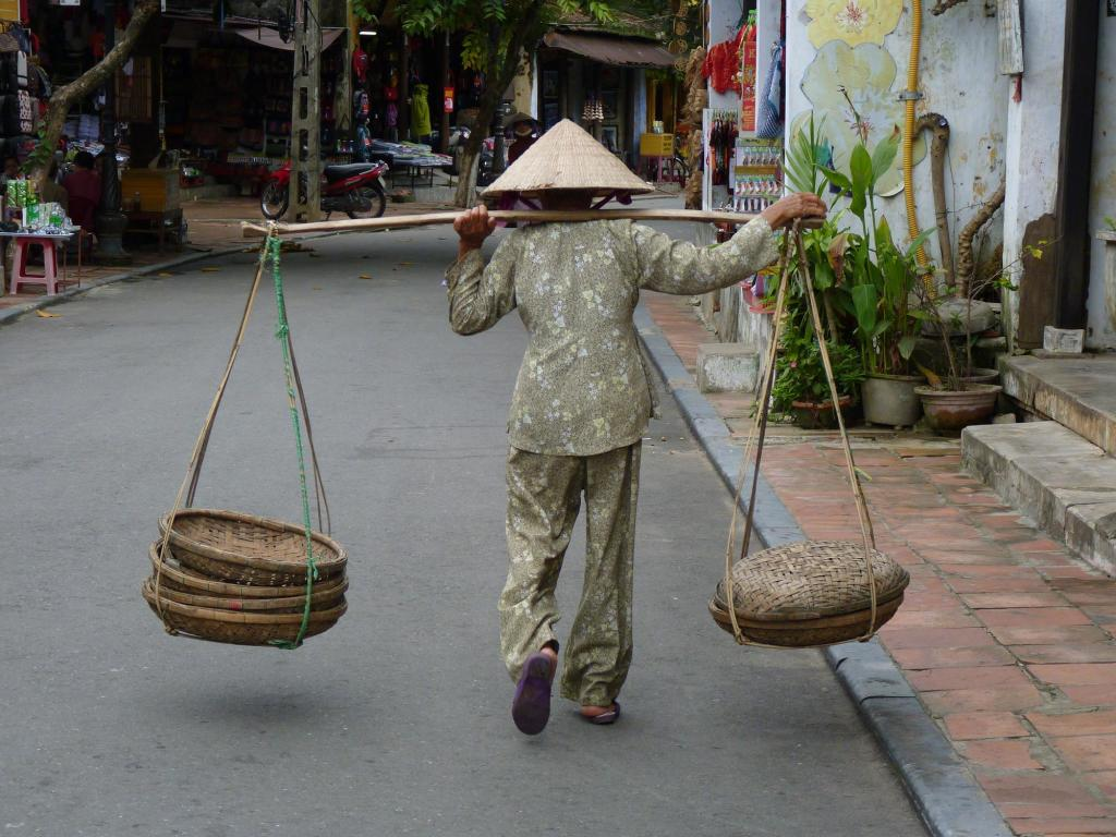 Hoi An, Vietnam - if you're old you still keep working...