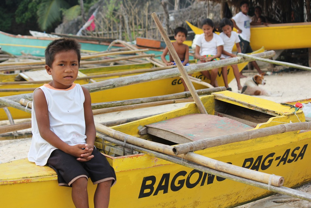 A pupil resting in one of the yellow boats